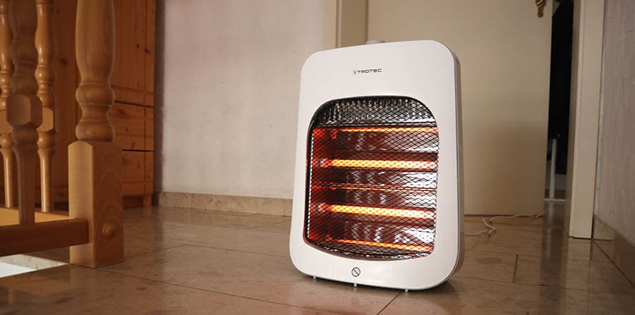 an infrared space heater on the floor stairs